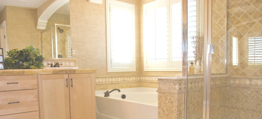 picture of custom bathroom renovation with soaking tub and custom tile work